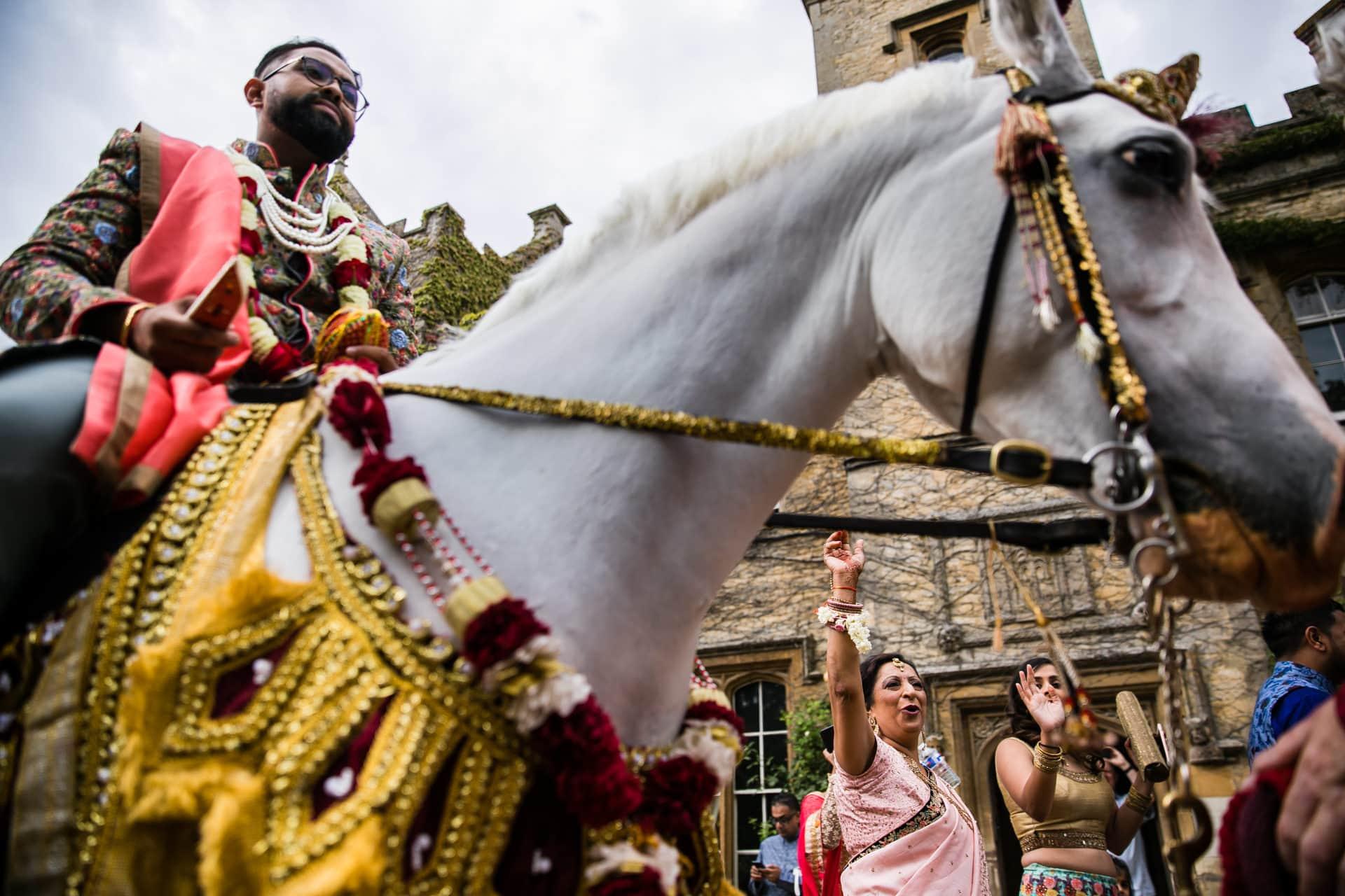 Asian Wedding groom arrival on horse