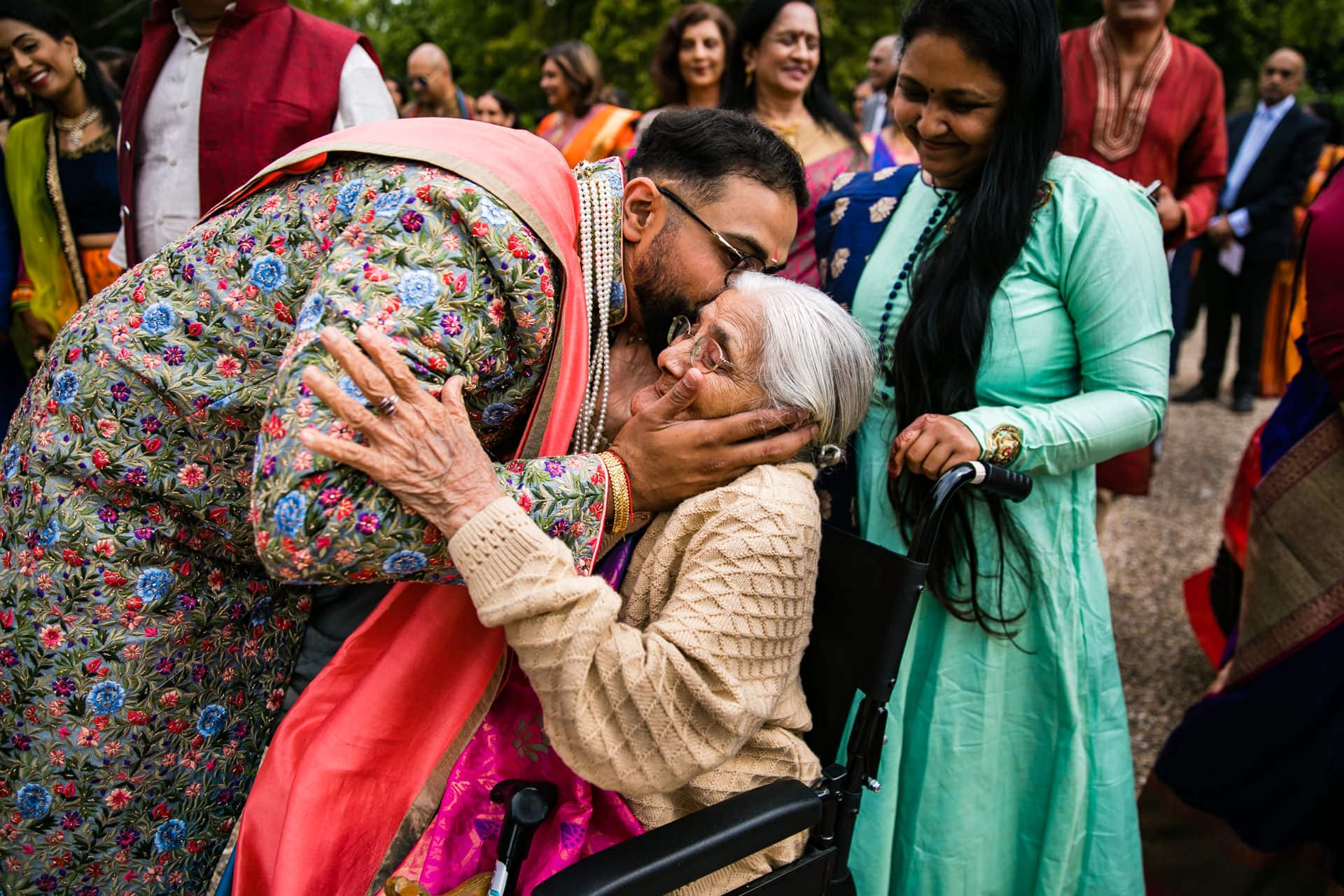 Groom kissing Gran on cheek
