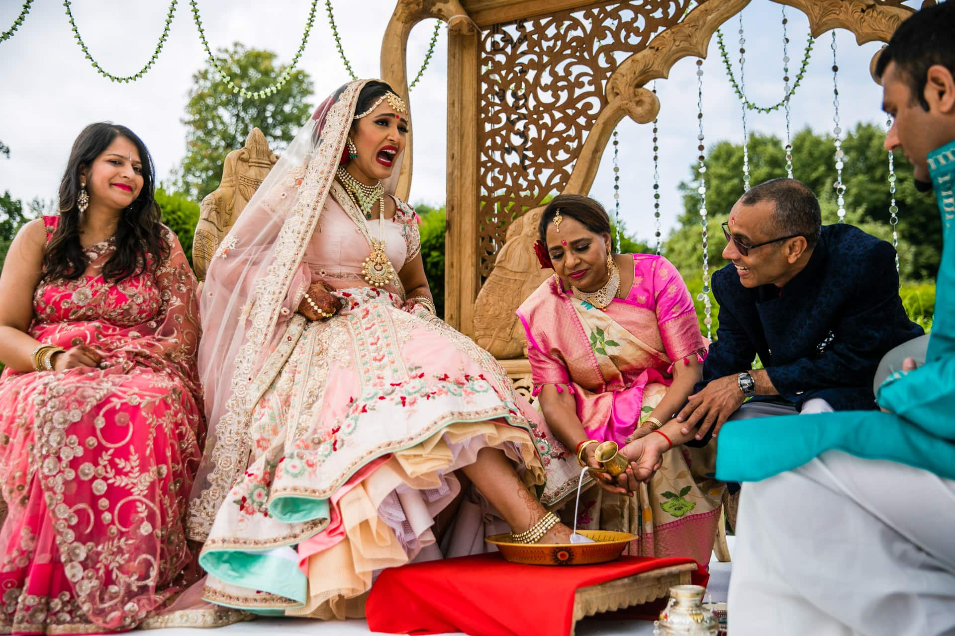 Feet washing ceremony during Gujarati wedding