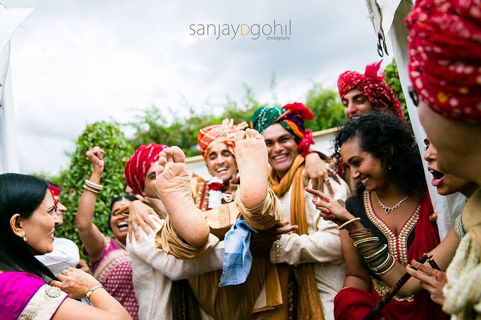 Hindu groom being lifted
