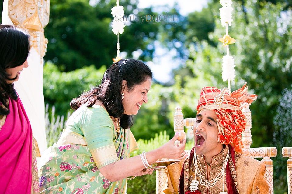 Wedding guest feeding groom