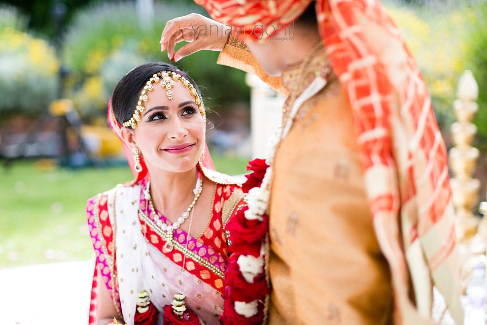 Hindu Groom putting Sindoor into parting of his bride