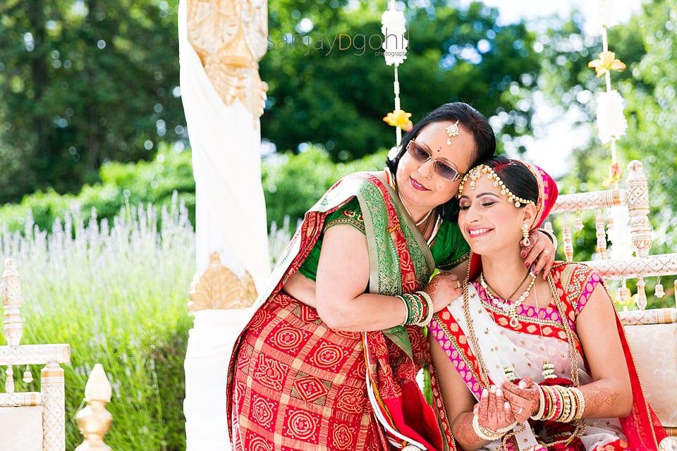 Mum and bride hugging