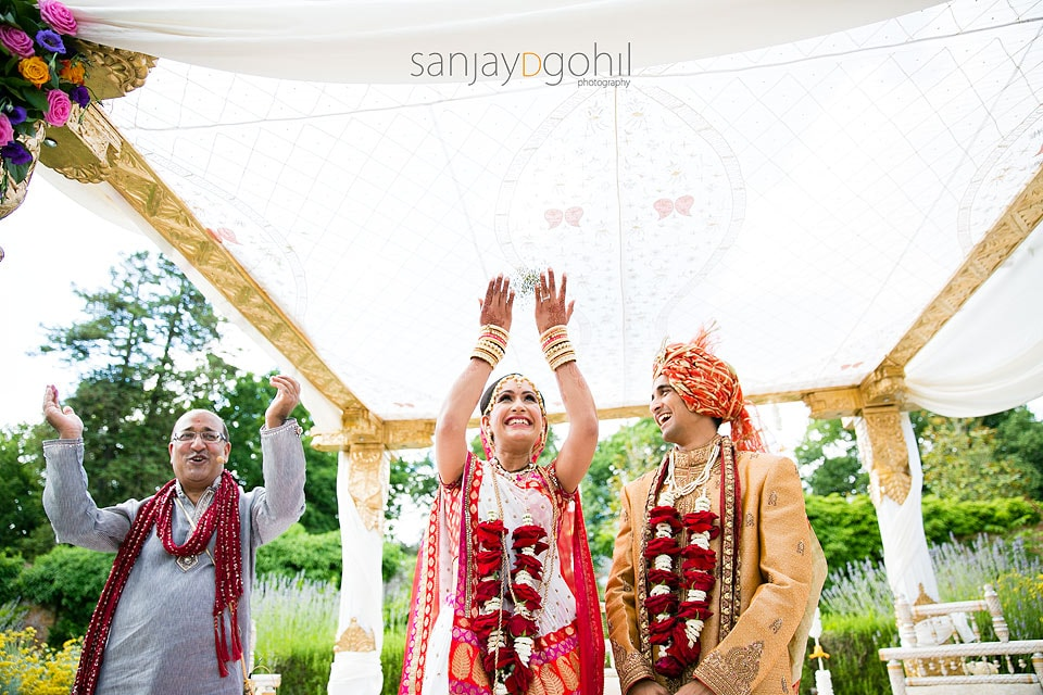 End of Hindu Wedding ceremony, bride throwing mung beans into the air