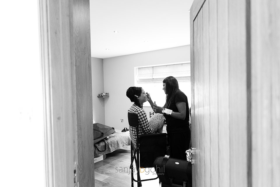 Asian bride getting ready by Ketna Dipali MUA