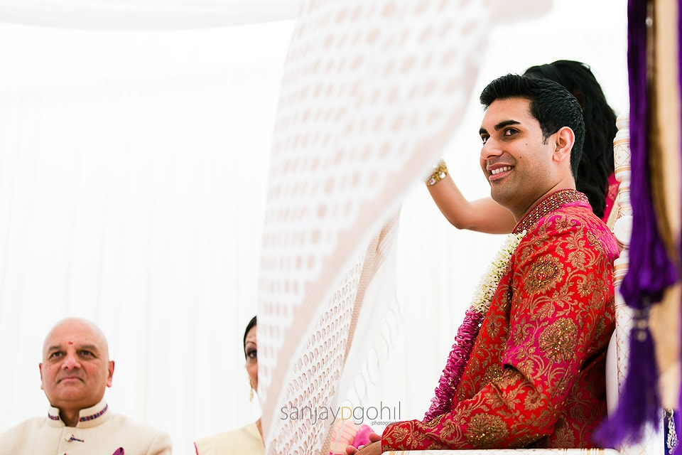 Asian wedding groom being the antarpath