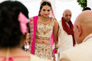 Asian Wedding bride smiling at her mum