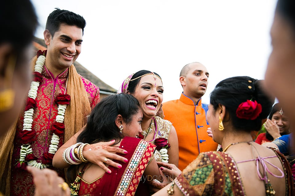 Bride hugging family members during vidhai ceremony