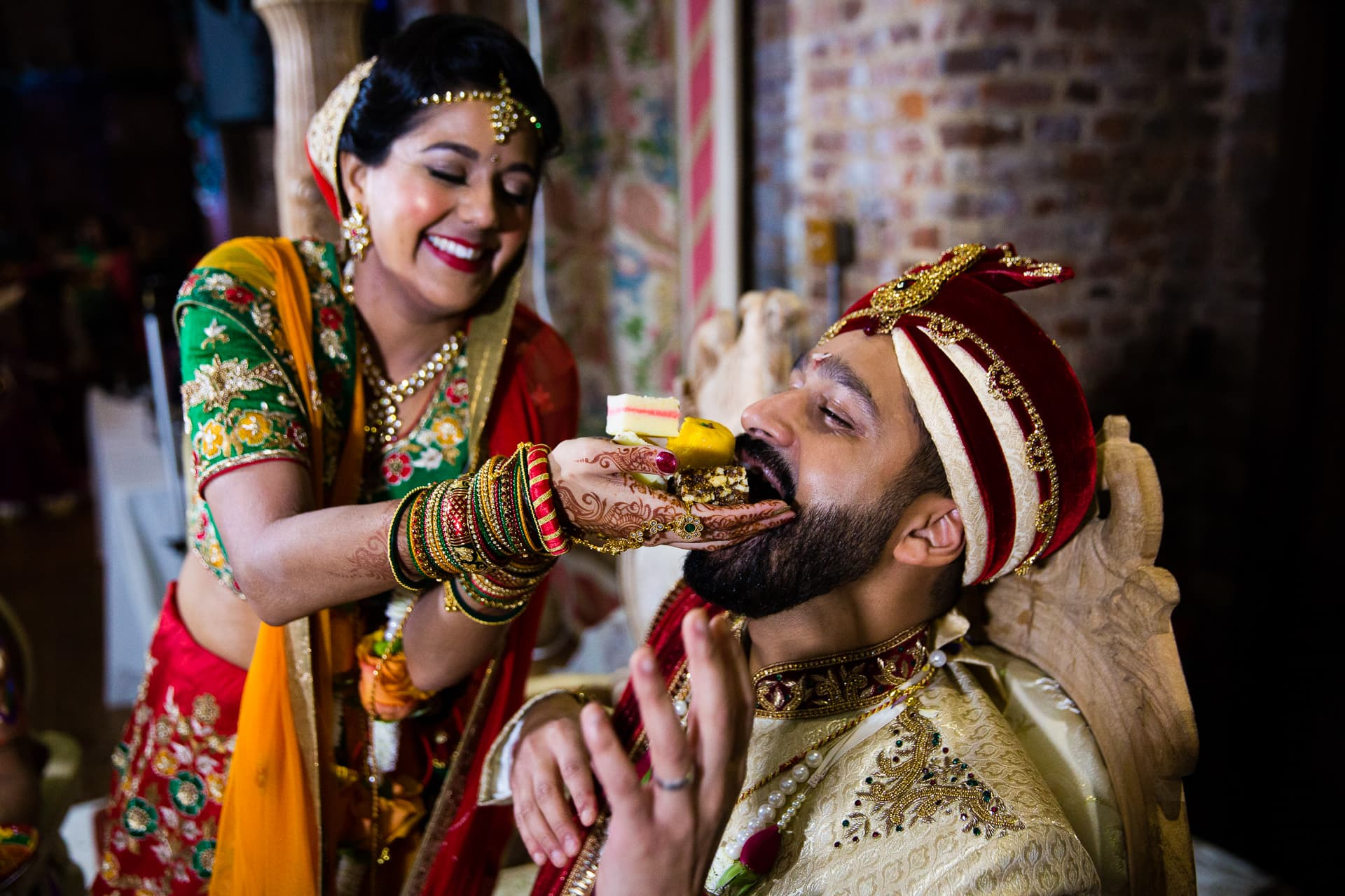 Bride feeding groom sweets