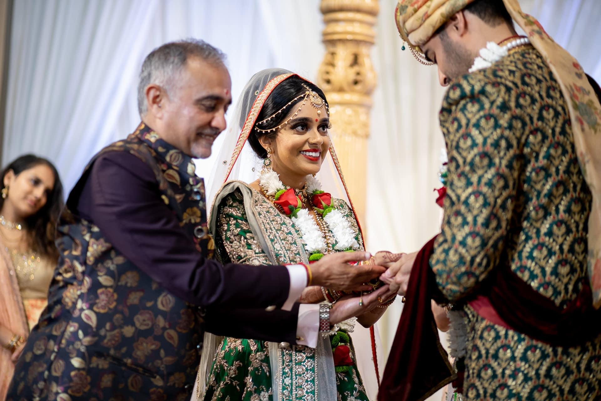 Groom handing bride's hand away in Marriage