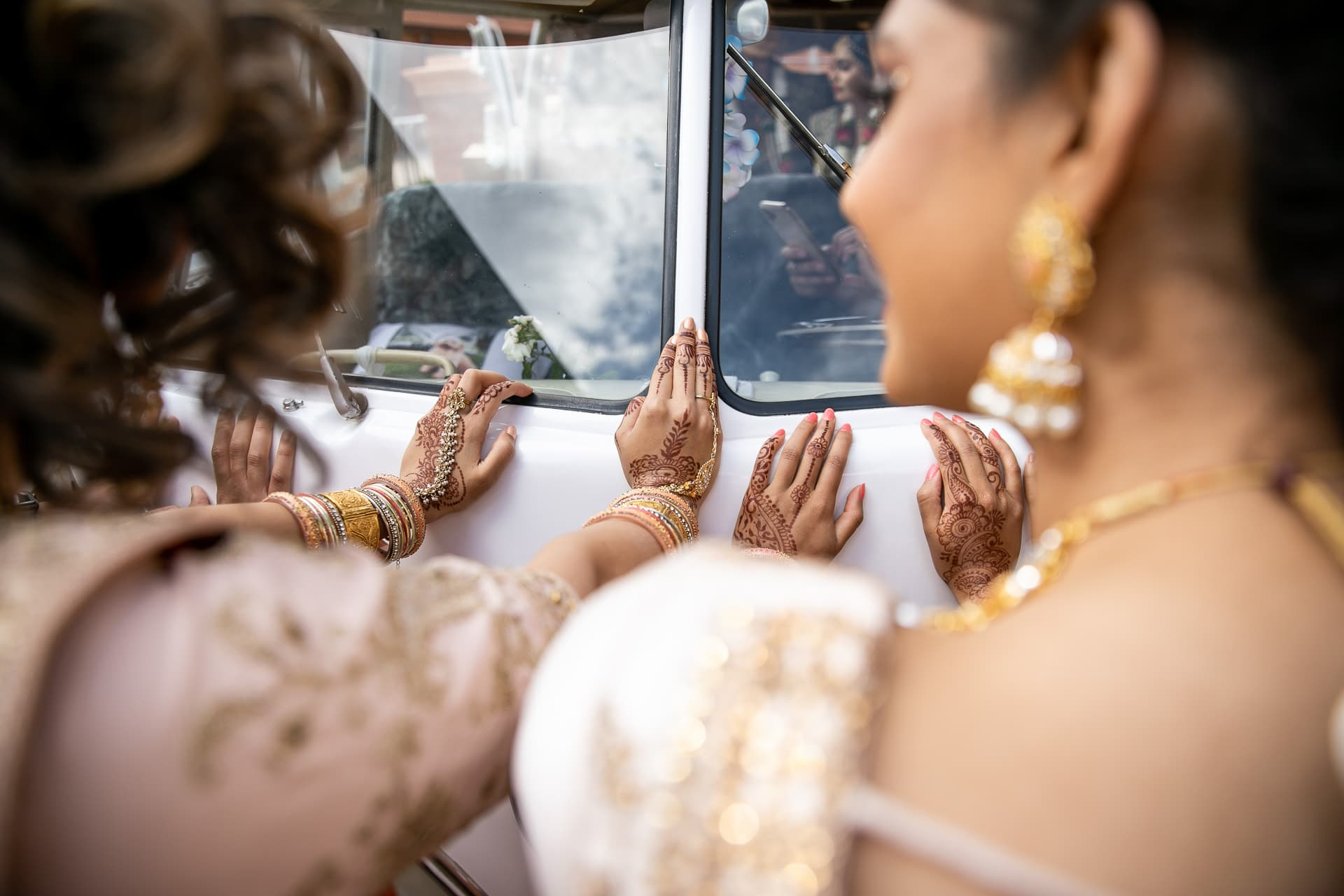 Bride's sisters stopping the car