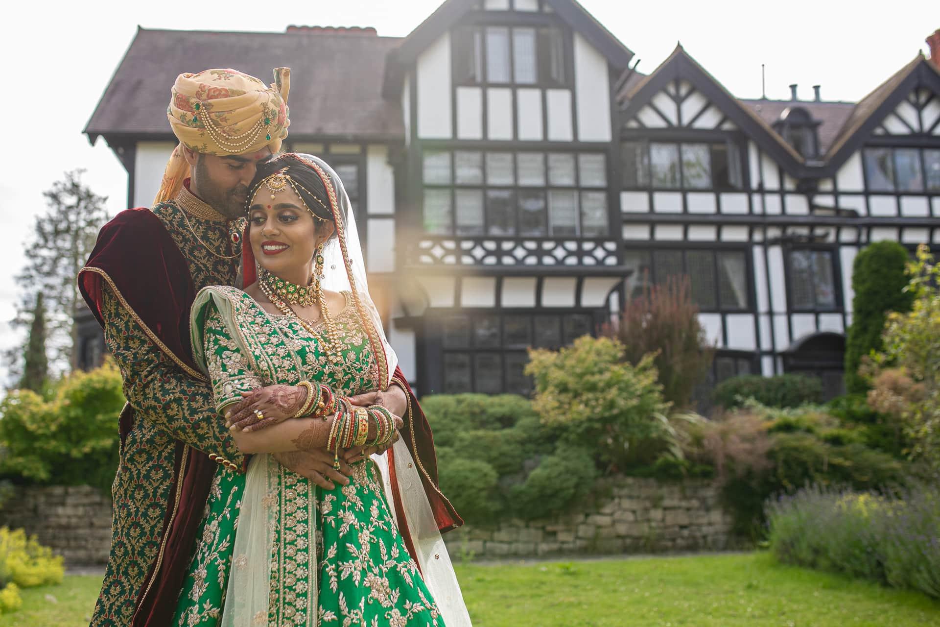 Asian bride and groom portrait at Bhaktivedanta Mandir, watford
