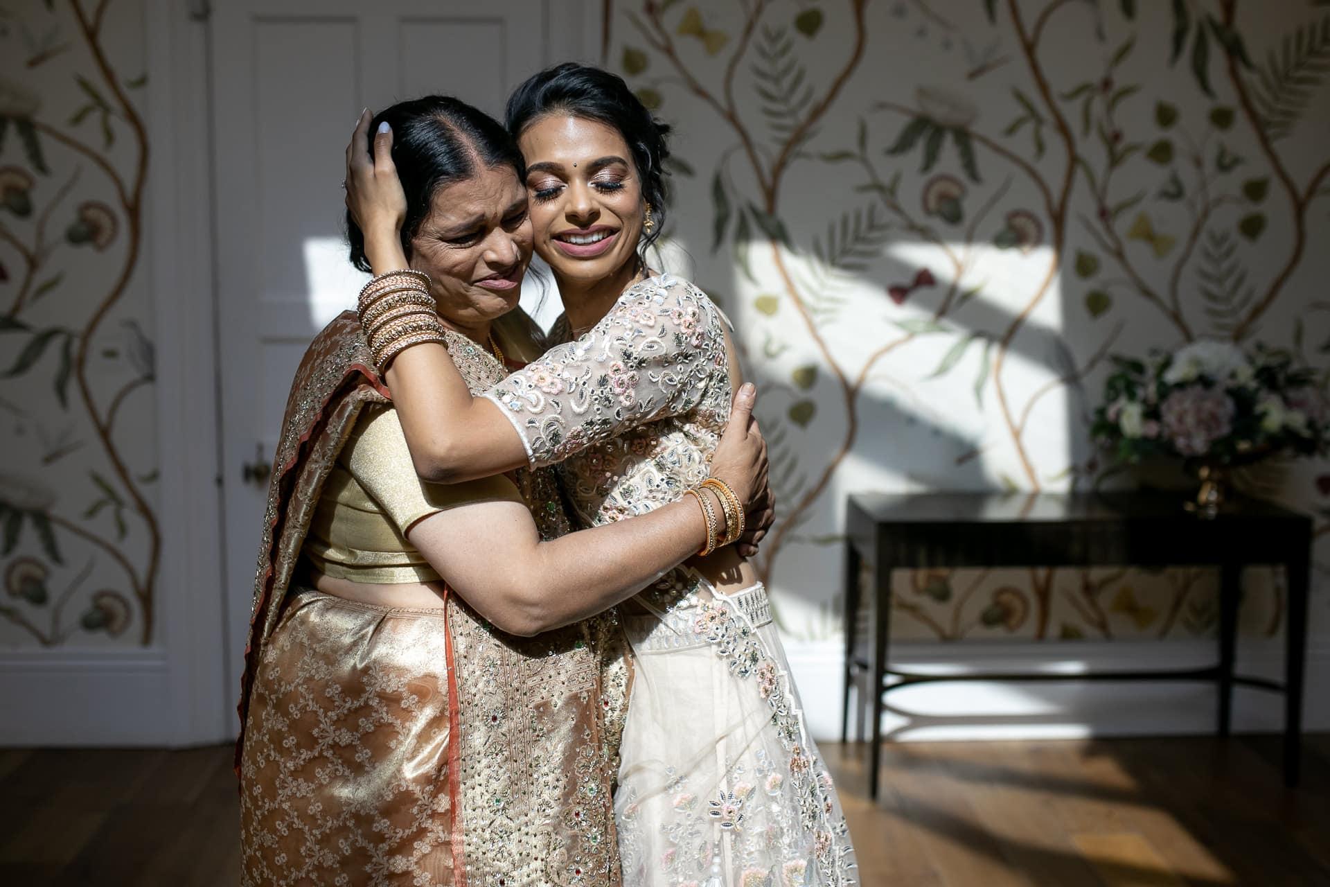 Bride hugging mum before Civil