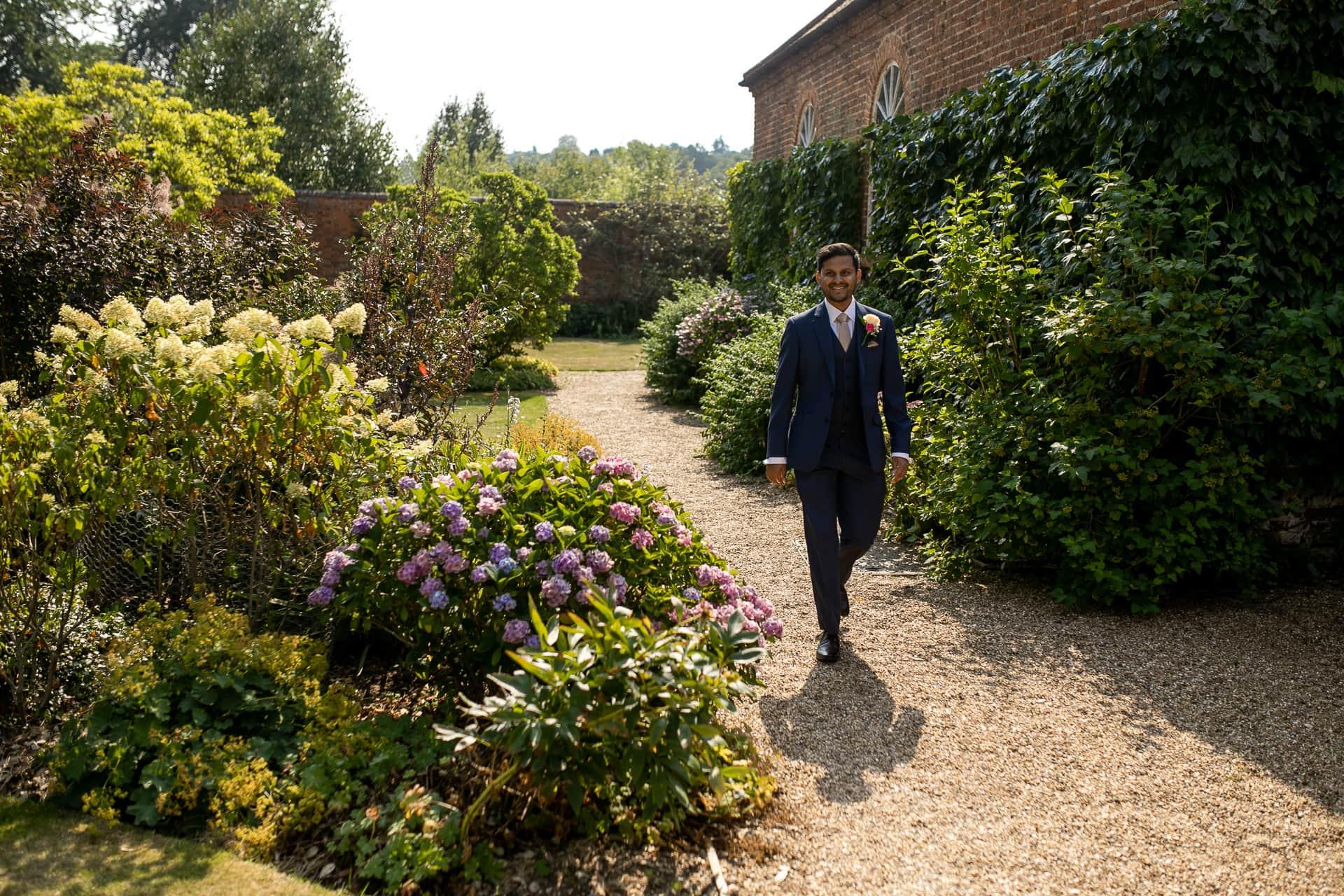Groom walking to civil wedding