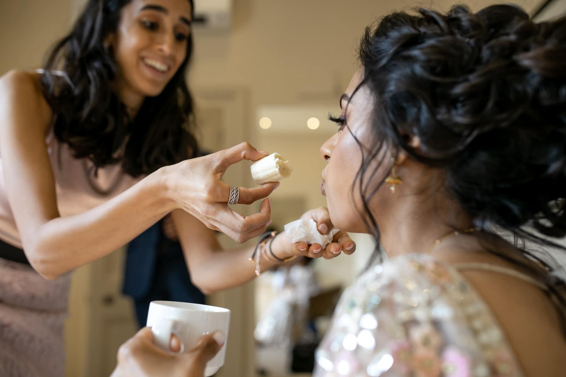 Bride eating Banana before Civil