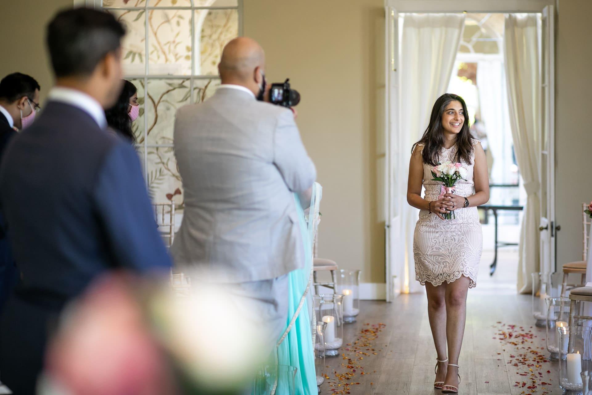 Bridesmaid walking down the isle
