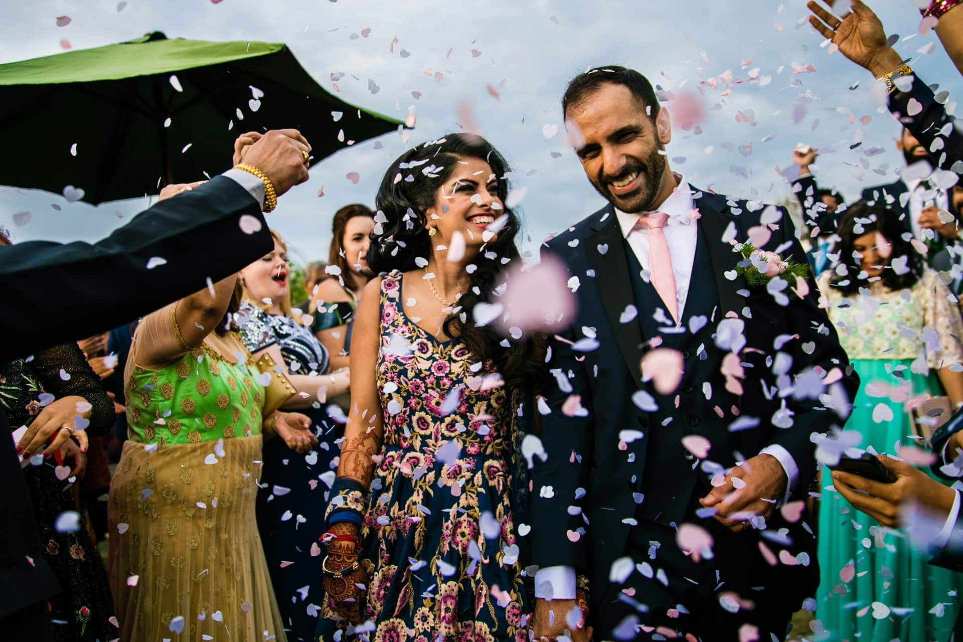Confetti being thrown at the bride and groom