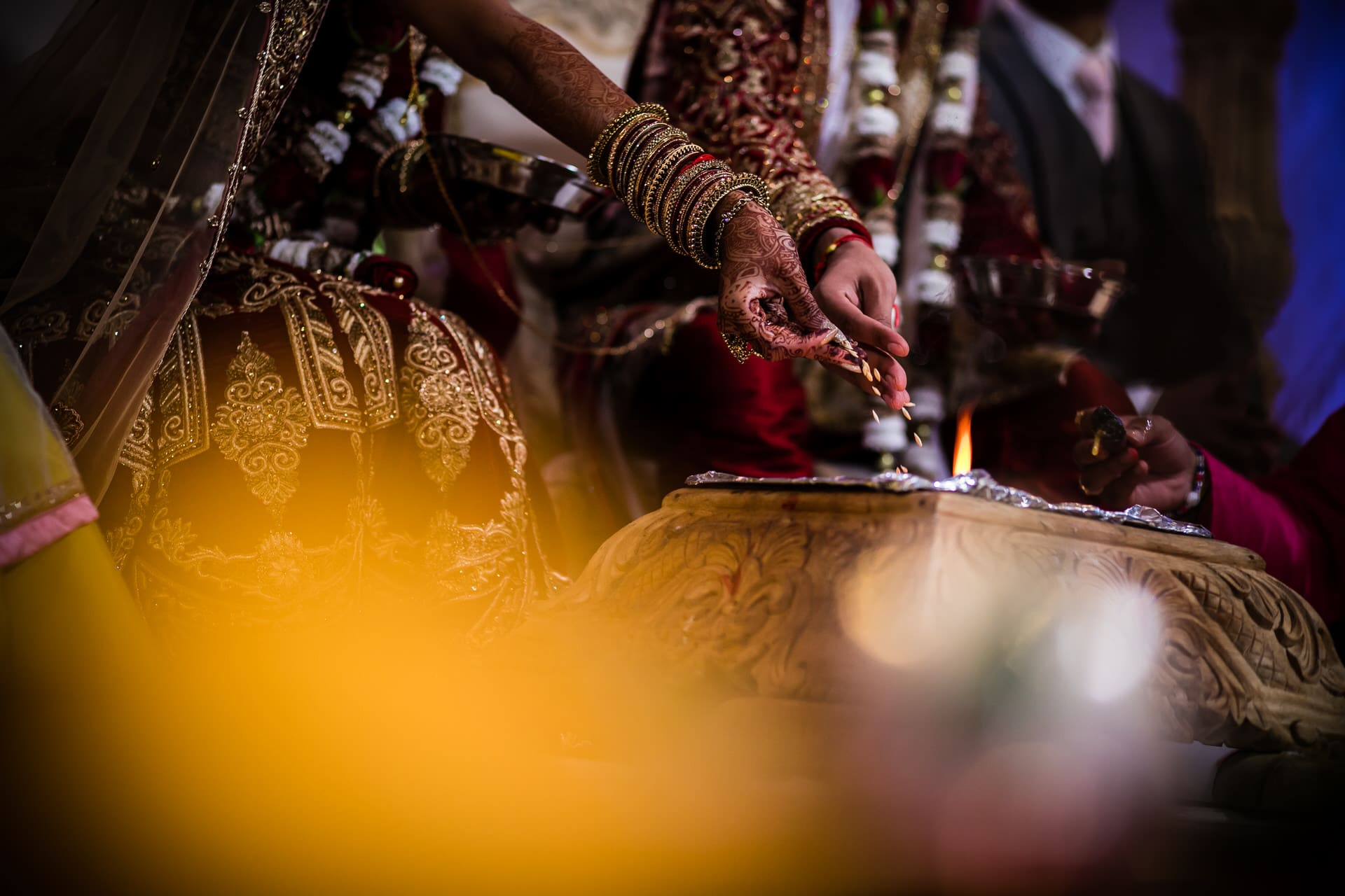Seeds being thrown in to the fire during Mandap ceremony