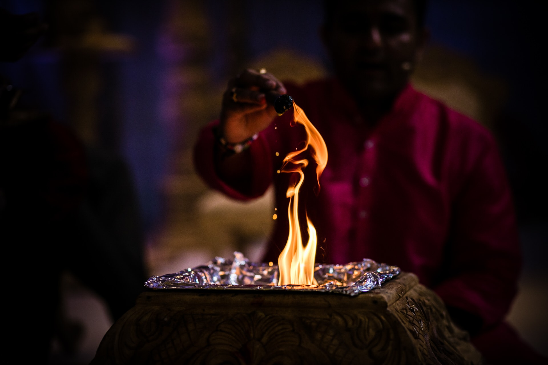 Milan Mehta pouring Ghee into the fire during Hindu Wedding ceremony