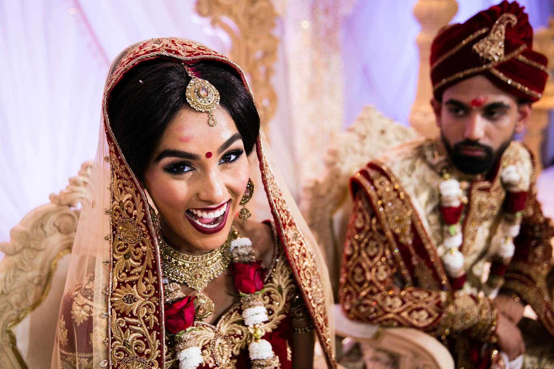 Bride with lipstick on her forehead