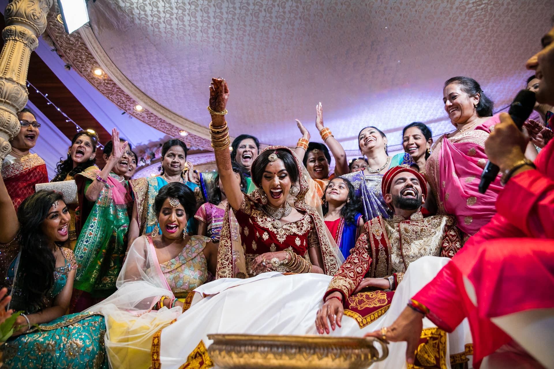 Indian bride and groom playing koda kodi