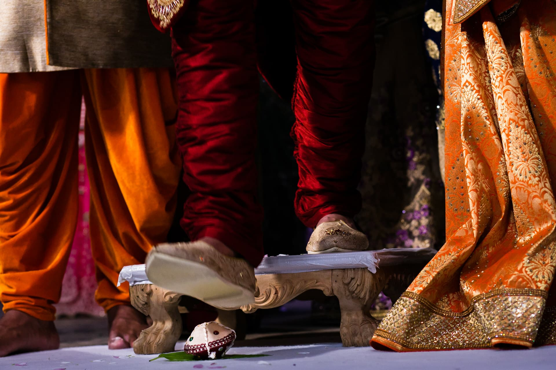 Groom stepping on Clay pot during Hindu Wedding
