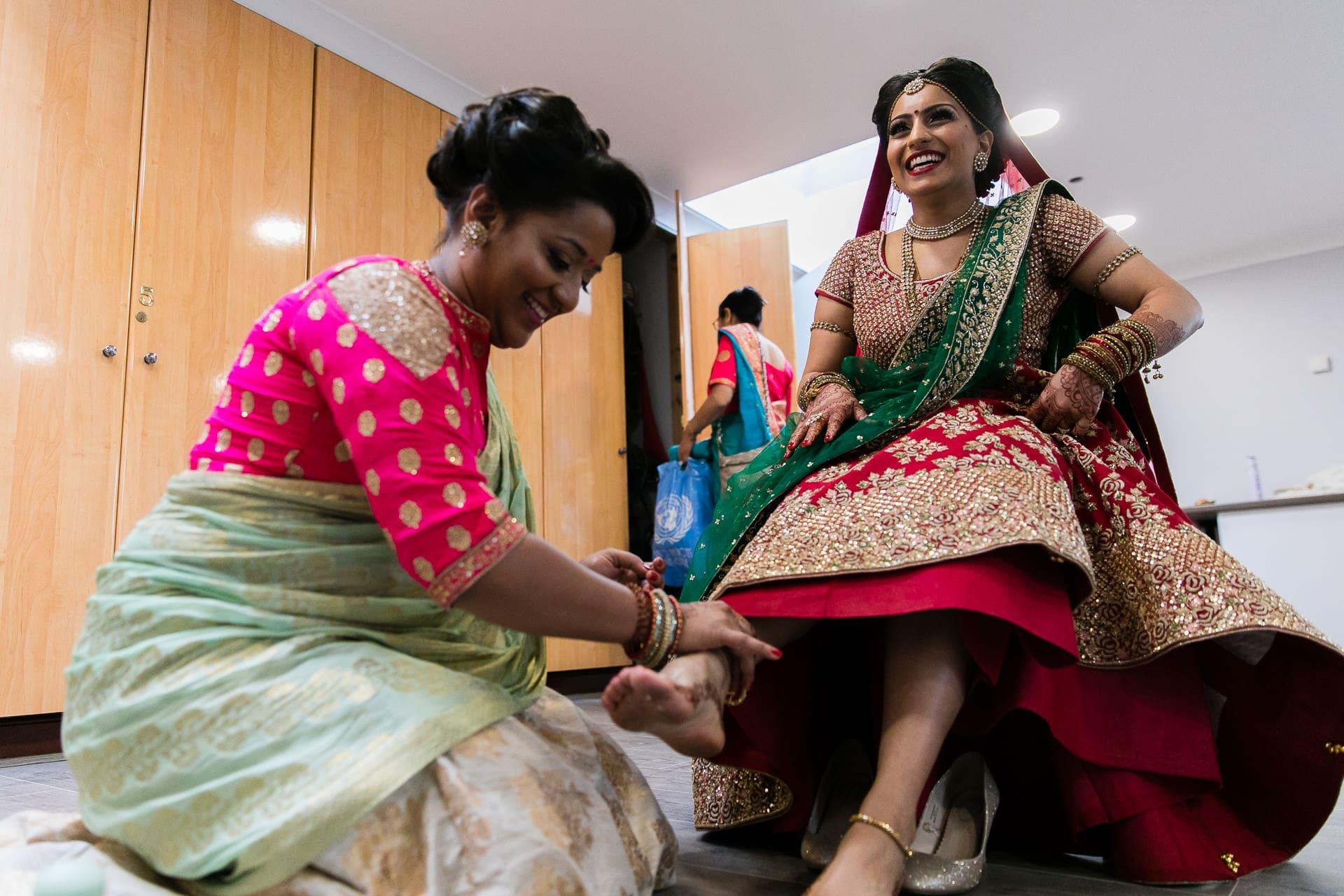 Bride having her feet cleaned