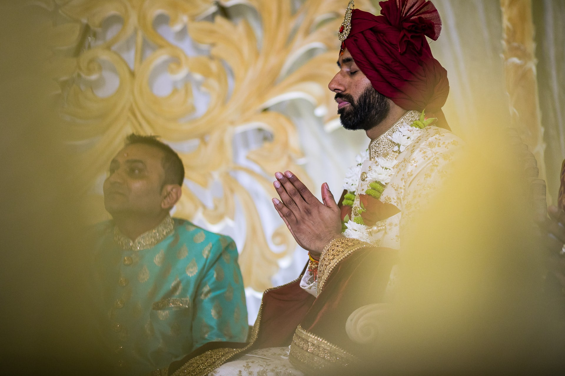 Asian wedding groom praying