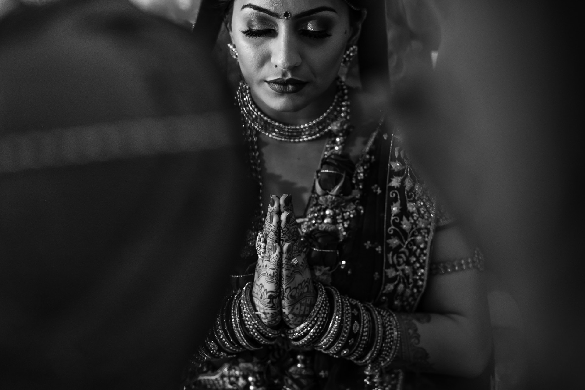 Bride with hands in Prayer position