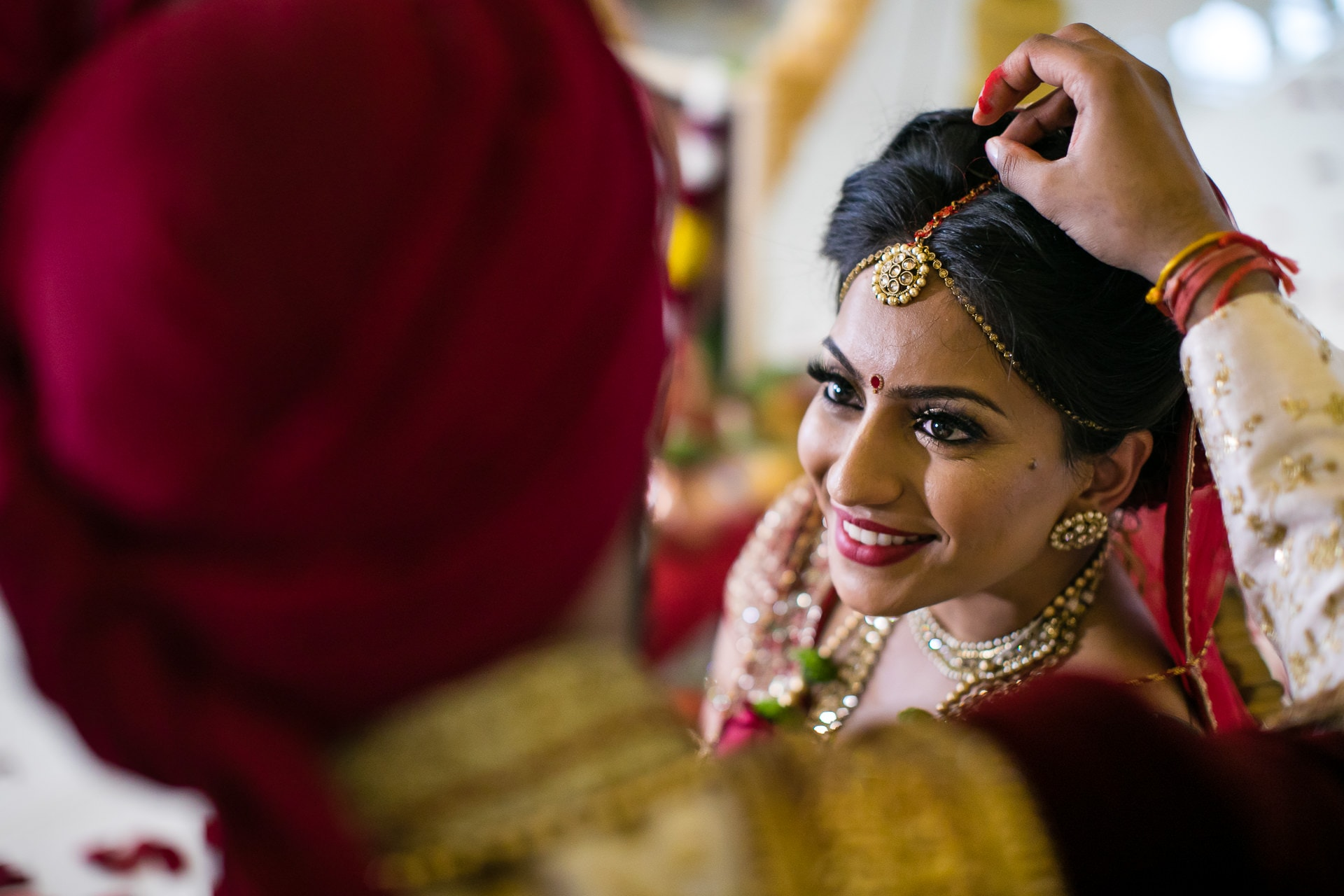 Groom placing Sindoor in the parting of the bride's hair
