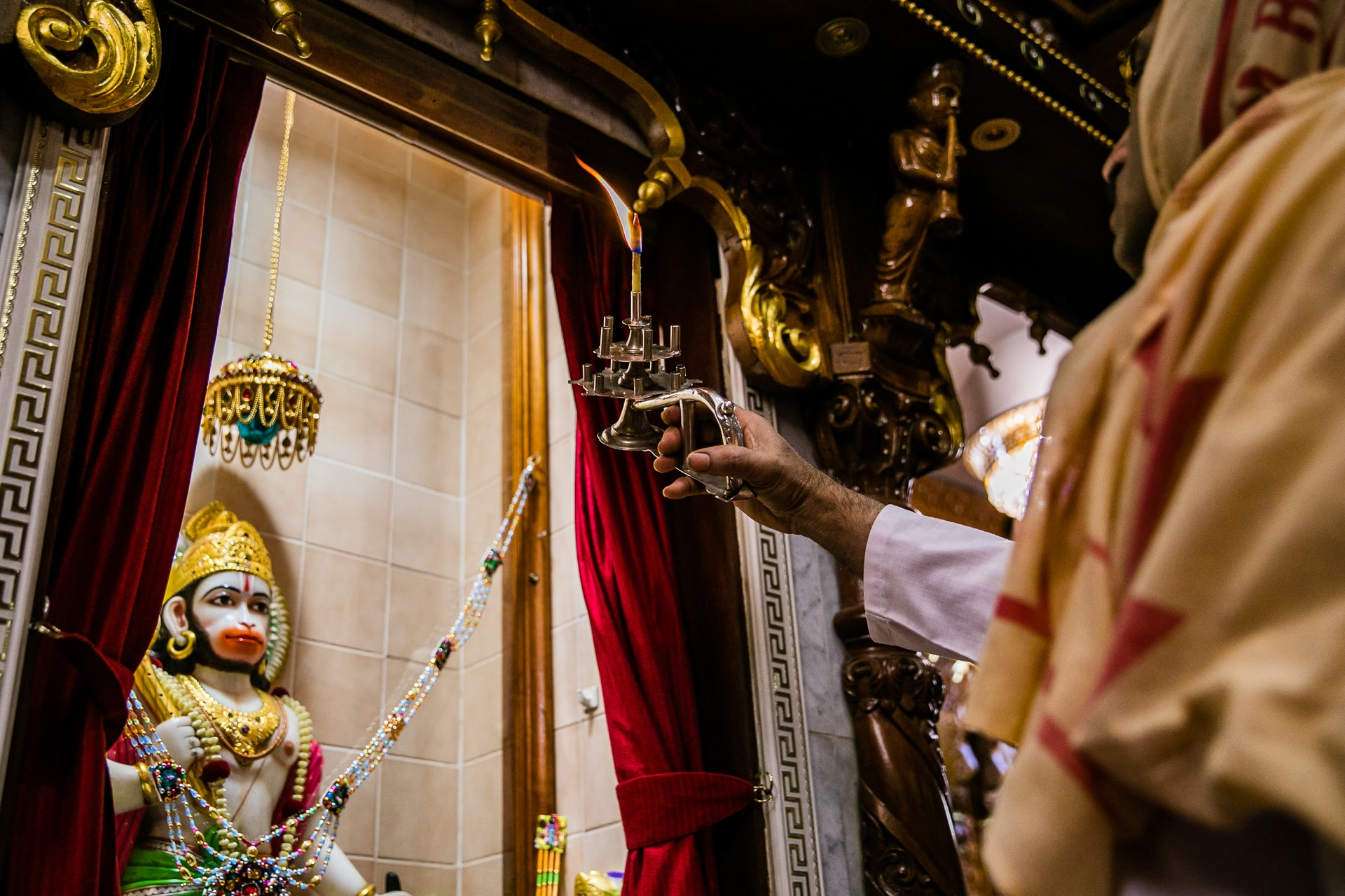 Groom praying inside Willesden Mandir