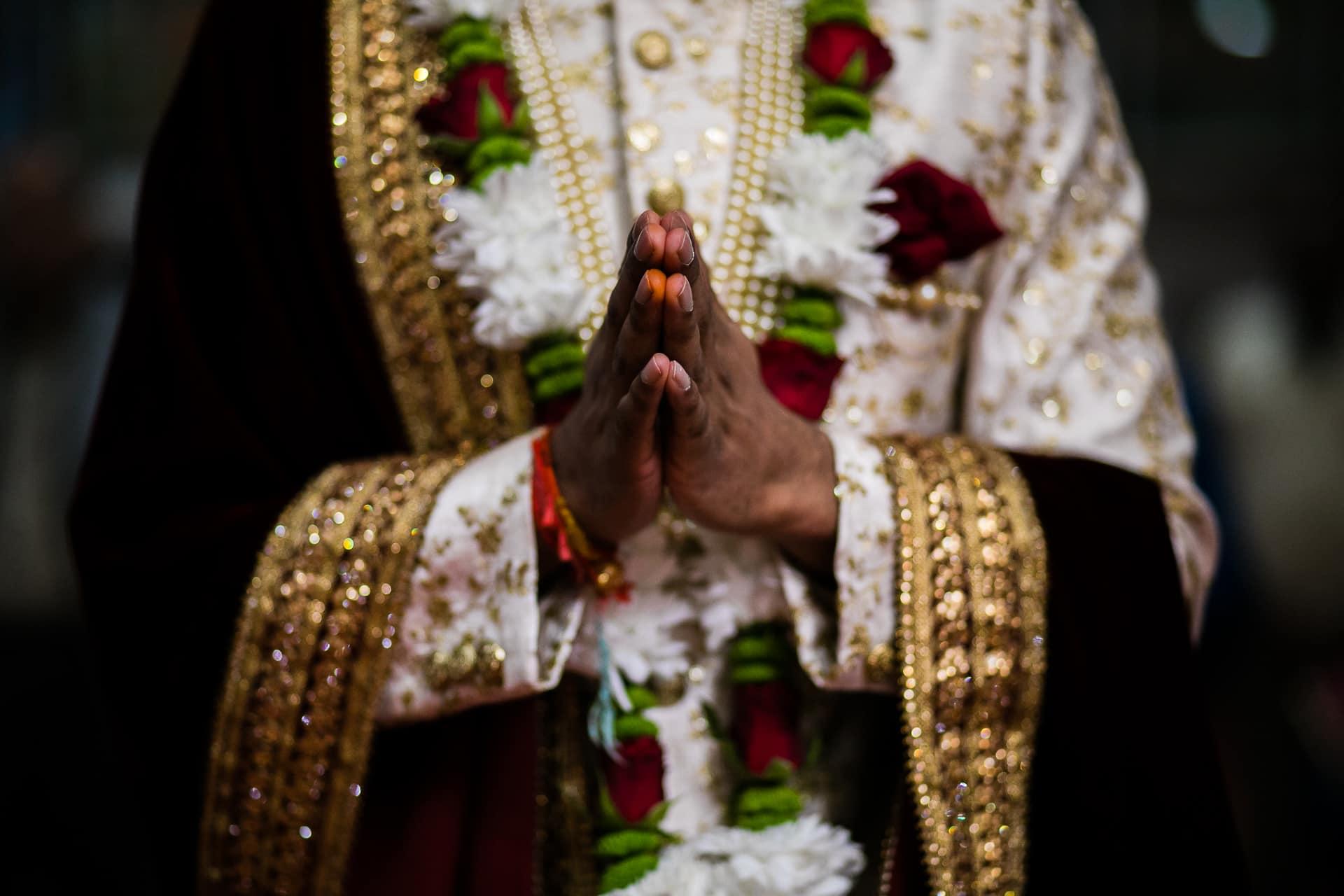 Wedding Groom's hands in prayer position
