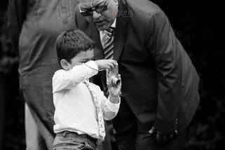 Boy taking photograph at wedding