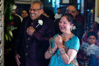 Parents of the groom laughing