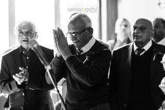 Hindu Wedding guest praying