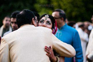 Bride hugging guest during vidhai
