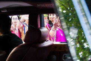 Guest waving goodbye through car window
