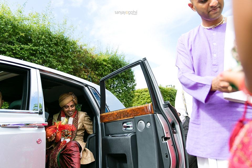 Hindu wedding groom getting out of the car