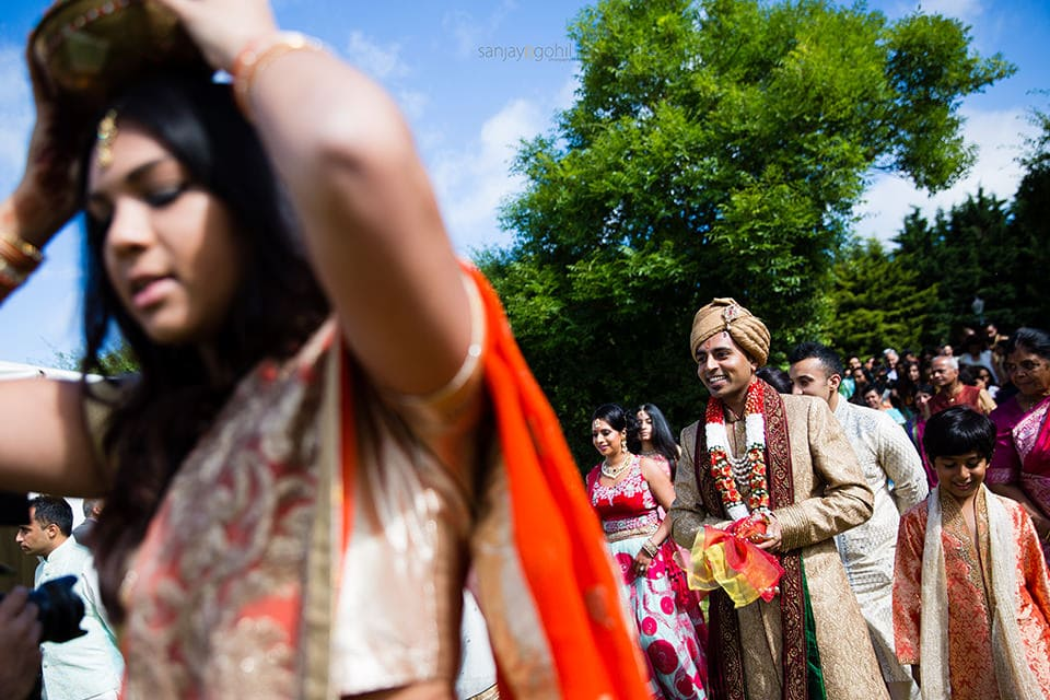 Hindu Wedding groom walking to mandap