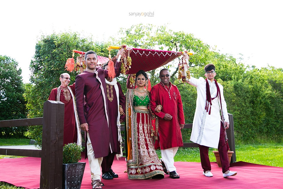Hindu Wedding bride arriving with uncles