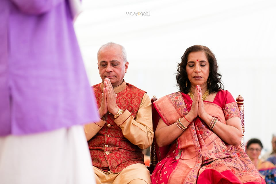 Groom's parents praying