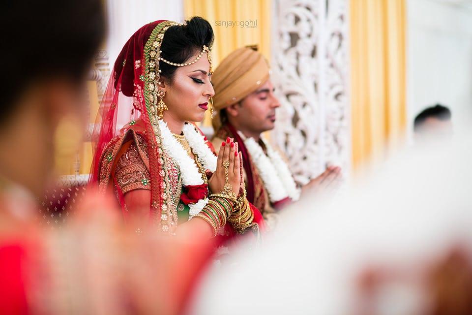 Hindu Wedding bride praying