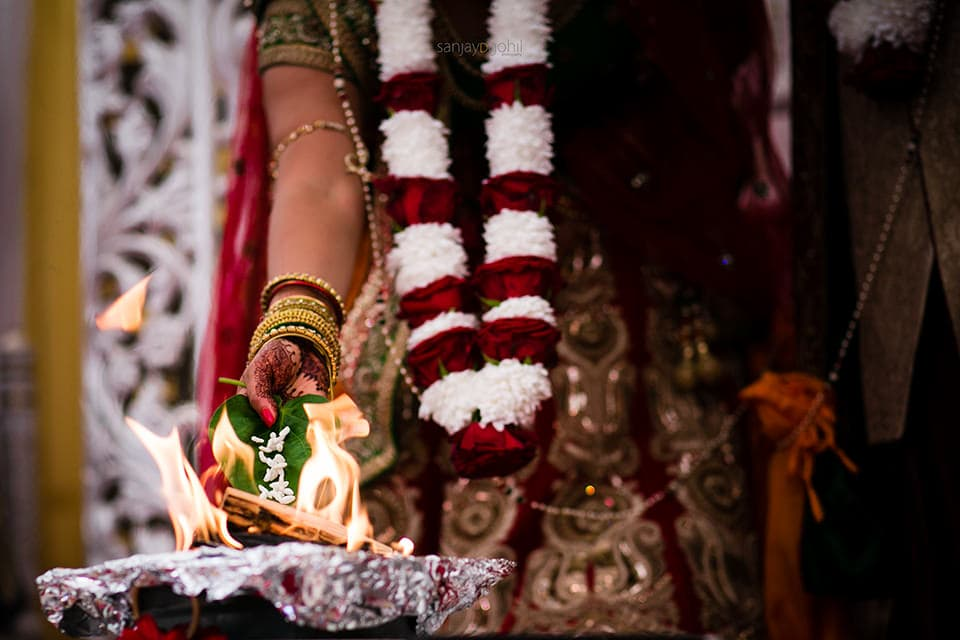 Seeds being poured into the fire during Hindu Weddnig