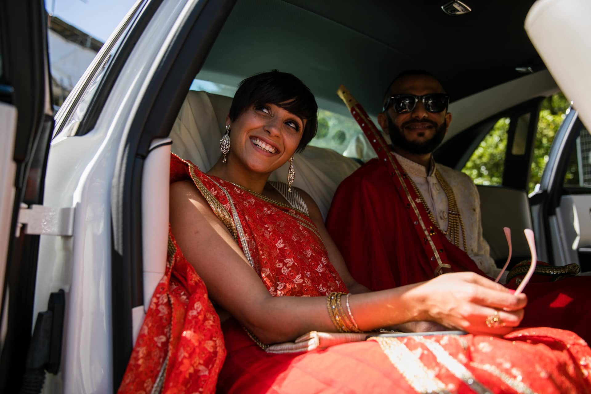 Groom inside wedding car