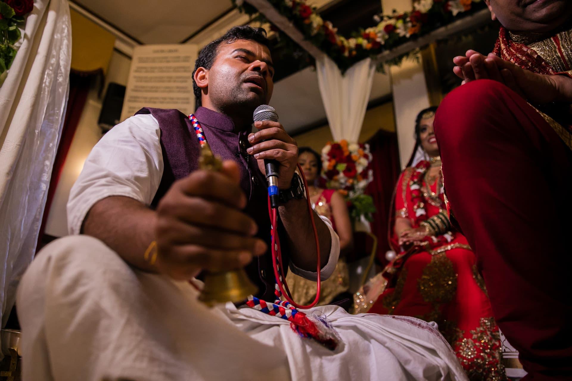 Asian Wedding priest at Hare Krishna Mandir