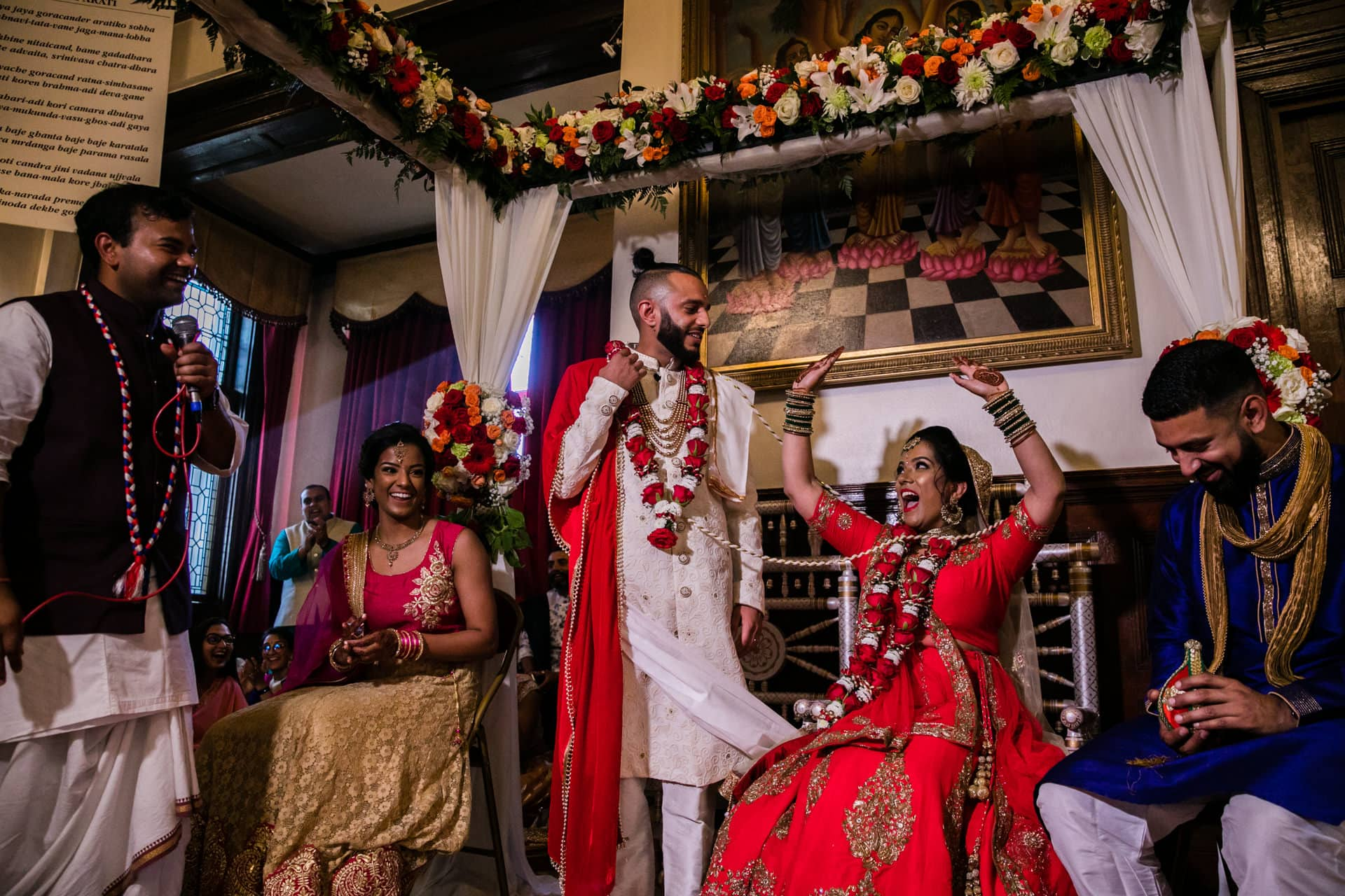 Asian Bride sits down before groom