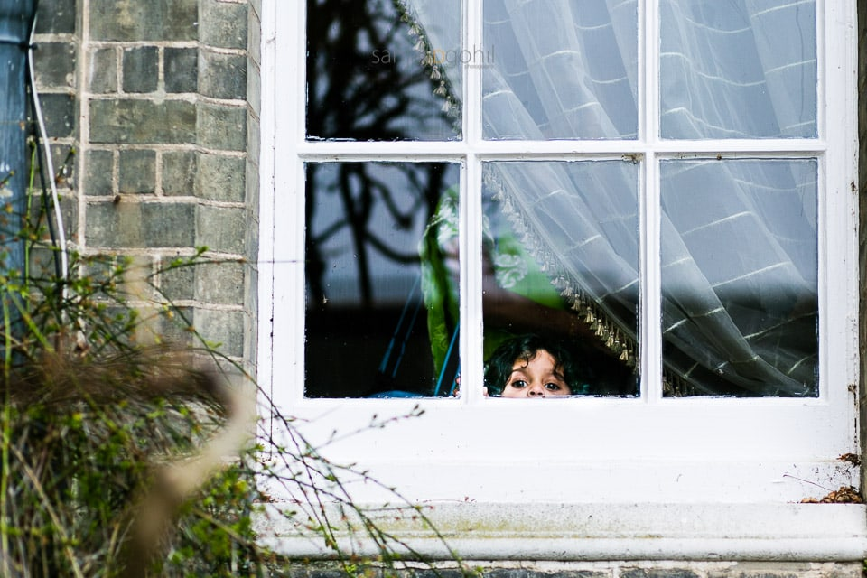 Wedding guest looking through the window
