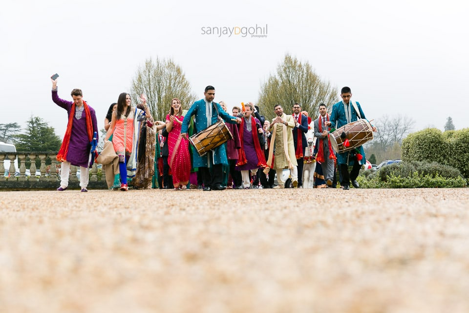 Groom's wedding party arrival with dhol players