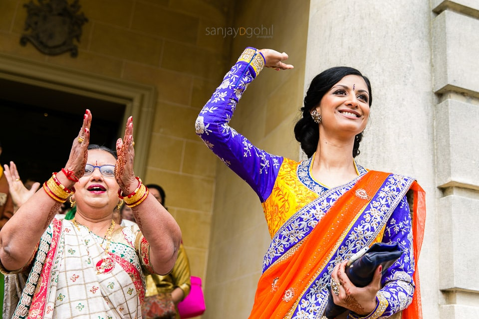 Sister and mother of bride dancing