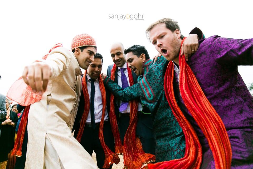Wedding groom and friends dancing